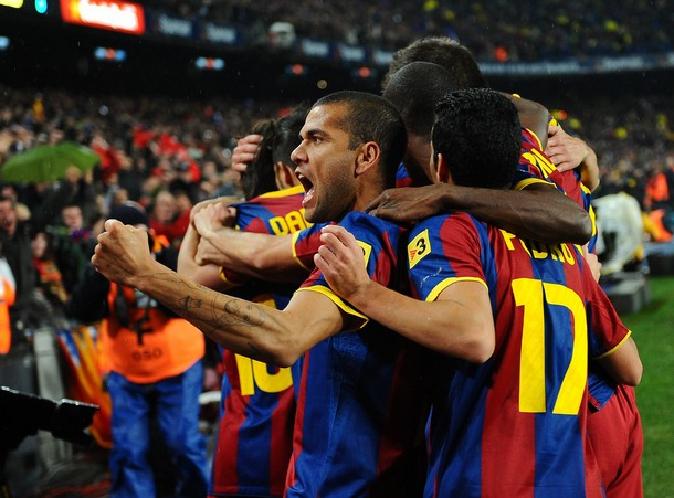 "Barcelona's Brazilian defender Daniel Alves da Silva (L) celebrates his team's goal during the Spanish league ""clasico"" football match FC Barcelona vs Real Madrid on November 29, 2010 at Camp Nou stadium in Barcelona.    AFP PHOTO/ LLUIS GENE (Photo credit should read LLUIS GENE/AFP/Getty Images)"
